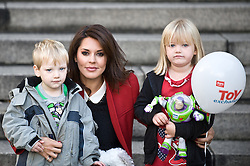 © Licensed to London News Pictures. 16/10/2012. London,UK.Danielle Lineker poses with young children in the front of the Royal Exchange in London to launch the Argos Toy Exchange .Photo credit : Thomas Campean/LNP.