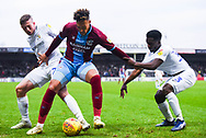 Kyle Wootton of Scunthorpe United (29) holds off Tom Bayliss of Coventry City (20) and Brandon Mason of Coventry City (3) in the corner during the EFL Sky Bet League 1 match between Scunthorpe United and Coventry City at Glanford Park, Scunthorpe, England on 5 January 2019.