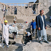 This is Kaka Khalil with local builders. He has 7 children up to the age of 13, including a new born baby who is only ten days old. He lives with his three brothers. His father lived in this house and his grandfather before him. His father was tailor for king Zahir Shah. Kaka Khalil acts as a community representative.  The residents of Murad khane  are enjoying improved conditions thanks to the  charity Turquoise Mountain  which was  was  set up by Rory Stewart. He was asked personally by Prince Charles to take on the task of rebuilding the ancient heart of Kabul. His charity using local labour and the goodwill of the community is substantially into the task and has also set up a school training Afghans in traditional crafts. The area had literally been turned into a rubbish dump, now though using ancient skills the buildings are being restored to their former glory, Stewart is hopeful that he can contribute significantly to the local economy.