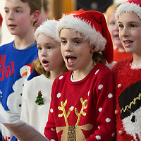 Clara Coote-Ryan, Sheena Kerins and Honor Murphy sing in the choir during the Nativity Play at Barefield Church