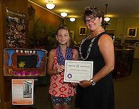 Emma Juliet Fabian receives a certificate of appreciation from Brenda Kean of the Laconia Historical and Museum Society for the model she submitted for the Colonial Theater Art Contest.   (Karen Bobotas/for the Laconia Daily Sun)