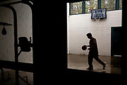 A detained juvenile plays basketball during recreation yard time at Nevada County Juvenile Hall on Wednesday, Jan. 16, 2019, in Nevada City, Calif.