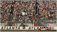 HAMPTON, GA:,Carl Edwards gets the checkered flag as he approaches the finish line to win the Pep Boys Auto 500 at Atlanta Motor Speedway on Sunday10/26/08. ©2008 Johnny Crawford