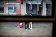 Face masks are mandatory in public life in the Czech Republic. A couple hugging at the railway station in Klatovy, Czech Republic, the first bigger station after crossing the closed Czech-German border. Czech Republic is in the state of emergency and just their own citizens or foreigners with a residence permit are allowed to enter.