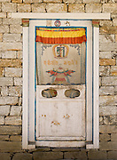 A decorated door in a house in the Khumbu District, in Himalaya of eastern Nepal.