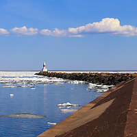 """""""Marquette Breakwater Lighthouse""""<br /> <br /> Scenic Marquette Michigan on a beautiful late spring day with icebergs still afloat on Lake Superior at Presque Isle Harbor!The long jetty and lighthouse stretching into the distance!"""