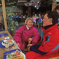 A couple enjoys lunch in Whiskey Jack's Bar and Grill during a break from skiing at Montana's Big Sky resort.