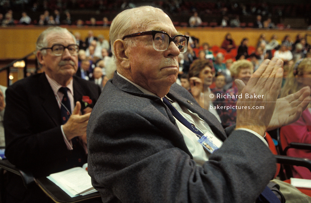 A Conservative Party delegate applauds Prime Minister John Major's closing speech at the 1992 Conservative Party Conference, on 18th March 1992, in Brighton, England. John Major went on to win the general election weeks later and was the fourth consecutive victory for the Tory Party although it was its last outright win until 2015 after Labour's 1997 win for Tony Blair.