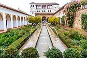 Patio de la Acequia in the gardens of Generalife, Alhambra Palace, Granada, Spain