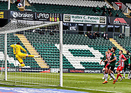 Plymouth Argyle Goalkeeper Michael Cooper (1) makes a diving top corner flying save  from Sunderland Midfielder Chris Maguire (7)  free kick  during the EFL Sky Bet League 1 match between Plymouth Argyle and Sunderland at Home Park, Plymouth, England on 1 May 2021.