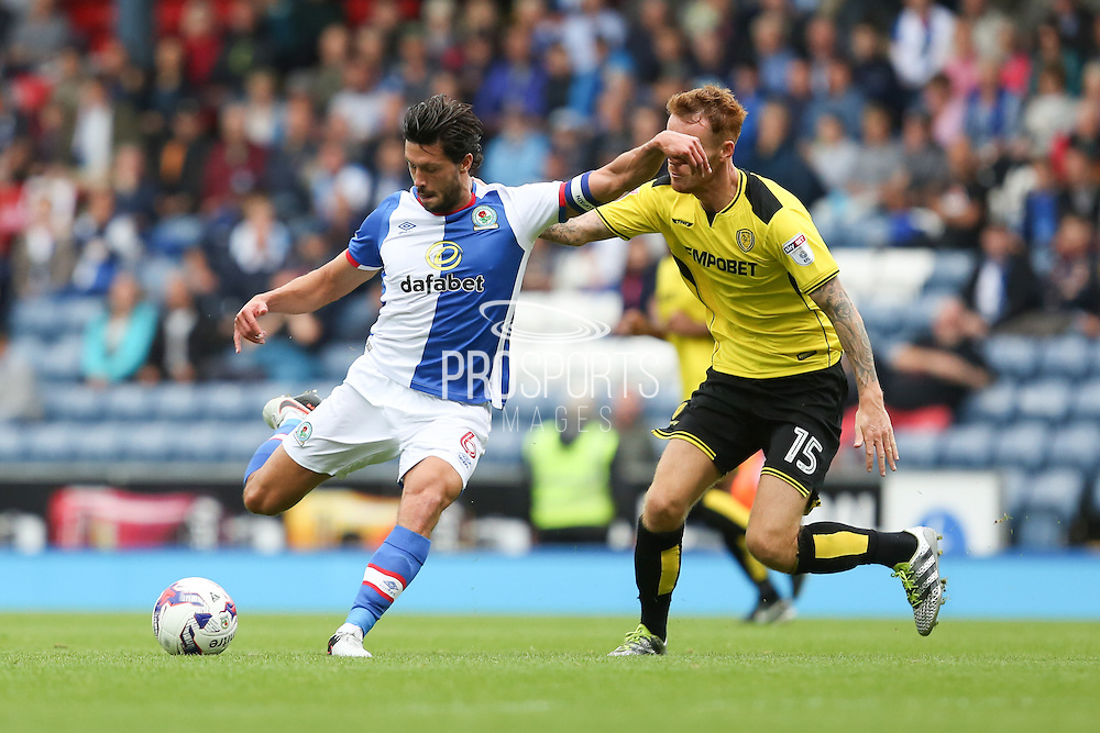 Jason Lowe of Blackburn Rovers tries a shot under pressure from Tom Naylor of Burton Albion during the EFL Sky Bet Championship match between Blackburn Rovers and Burton Albion at Ewood Park, Blackburn, England on 20 August 2016. Photo by Simon Brady.