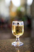 Selective focus on a glass of white wine, Outdoors