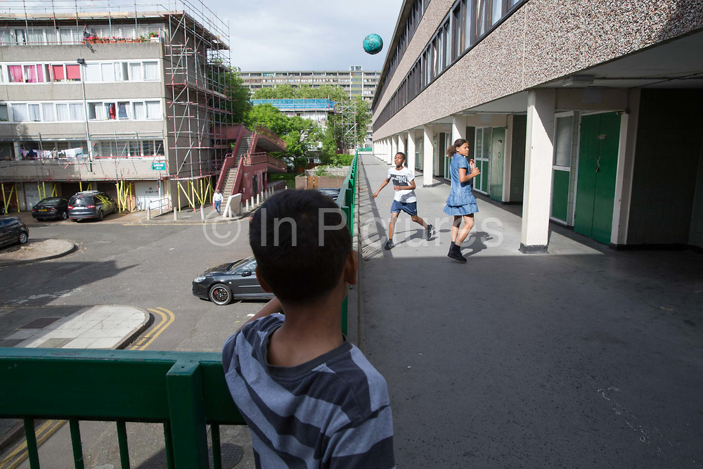 Young people playing on the Aylesbury Estate, a large housing estate located in Walworth, on 15th June 2016 in South London, United Kingdom. The Aylesbury Estate contains 2,704 dwellings and was built between 1963 and 1977. The estate is partially occupied and is currently undergoing a major redevelopment.