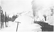 RGS rotary snowplow #2 clearing the track near Lizard Head Pass in 1935 as seen from the caboose.  Perhaps northbound between Lizard Head and Trout Lake.<br /> RGS  Lizard Head Pass, CO  1935<br /> Thanks to Don Bergman for additional information.
