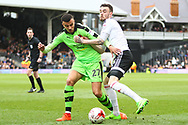 Romain Saiss of Wolverhampton Wanderers is being held by Scott Malone of Fulham and y during the Sky Bet Championship match at Craven Cottage, London<br /> Picture by Richard Brooks/Focus Images Ltd 07947656233<br /> 18/03/2017