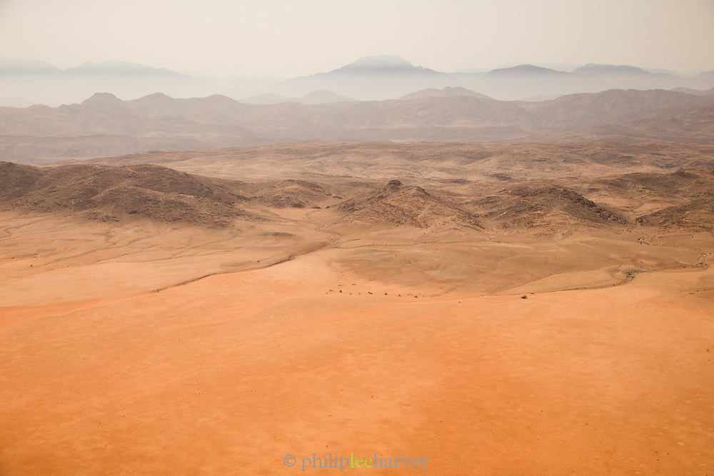 Landscape of Namib Desert and mountain ranges in distance, Skeleton Coast, Northern Namibia, Southern Africa
