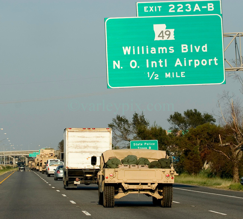 06 Sept, 2005. New Orleans, Louisiana. Hurricane Katrina aftermath. <br /> <br /> Military convoys finally stream down I-10, days after the catastrophic storm smashed New Orleans.<br /> Photo; ©Charlie Varley/varleypix.com
