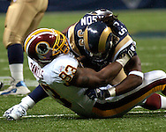 Washington Redskins defensive linemen Phillip Daniels (93) warps up St. Louis Rams running back Steven Jackson for a loss in the first quarter, during the Redskins 24-9 win at the Edward Jones Dome in St. Louis, Missouri, December 4, 2005.