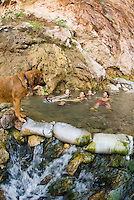 Hikers soak in The Nevada Hot Springs in The Black Canyon, Nevada.