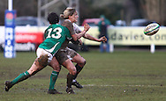 29 Feb 2010 Esher, Surrey: Fiona Pocock of England is tackled by Joanne O'Sullivan (13) of Ireland during the Women's Six Nations game between England and Ireland at Esher Rugby Club (photo by Andrew Tobin/SLIK images)