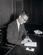 Seattle City Councilman Wing Luke, acting mayor for a week, signed his first official document in both Chinese – as Luke Wing Chung – and English. The document was a bond for a heating-equipment dealer's license.  Luke is the first person of color on the Seattle City Council and the first Asian American elected to public office in the Pacific Northwest. (Times staff photo by Larry Dion, 1964)