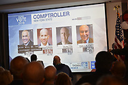 """Garden City, New York, USA. November 6, 2018. News 12 Long Island """"Island Vote 2018"""" - projected on large screen - shows how candidates are doing in votes counted so far, as Nassau County Democrats watch Election Day results at Garden City Hotel, Long Island."""