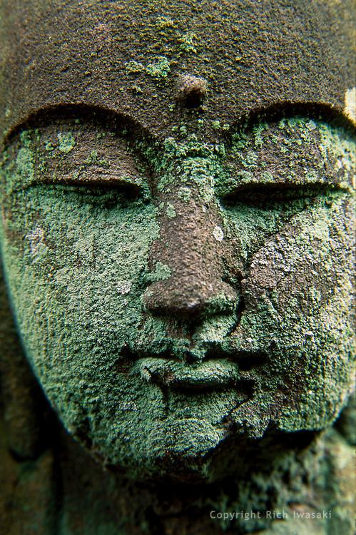 Closeup view of stone guardian (jizo) at Jyomyo-in (temple), Yanaka district, Tokyo, Japan