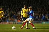 Football - 2019 / 2020 Emirates FA Cup - Fifth Round: Portsmouth vs. Arsenal<br /> <br /> Portsmouth's Cameron McGeeham leaves his foot in the challenge to foul Joe Willock of Arsenal during the FA Cup fixture at Fratton Park <br /> <br /> COLORSPORT/SHAUN BOGGUST