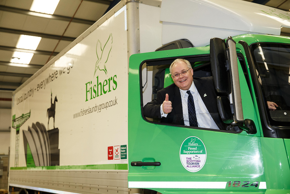 Michael Jones MD of Fishers Laundry in the driving seat at the unveiling of new truck livery at super laundry opening in Coatbridge.  Picture Robert Perry 17th March 2016<br /> <br /> Please credit photo to Robert Perry<br /> <br /> Image is free to use in connection with the promotion of the above company or organisation. 'Permissions for ALL other uses need to be sought and payment make be required.<br /> <br /> <br /> Note to Editors:  This image is free to be used editorially in the promotion of the above company or organisation.  Without prejudice ALL other licences without prior consent will be deemed a breach of copyright under the 1988. Copyright Design and Patents Act  and will be subject to payment or legal action, where appropriate.<br /> www.robertperry.co.uk<br /> NB -This image is not to be distributed without the prior consent of the copyright holder.<br /> in using this image you agree to abide by terms and conditions as stated in this caption.<br /> All monies payable to Robert Perry<br /> <br /> (PLEASE DO NOT REMOVE THIS CAPTION)<br /> This image is intended for Editorial use (e.g. news). Any commercial or promotional use requires additional clearance. <br /> Copyright 2016 All rights protected.<br /> first use only<br /> contact details<br /> Robert Perry     <br /> 07702 631 477<br /> robertperryphotos@gmail.com<br />        <br /> Robert Perry reserves the right to pursue unauthorised use of this image . If you violate my intellectual property you may be liable for  damages, loss of income, and profits you derive from the use of this image.