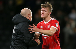Nottingham Forest manager Mark Warburton with Joe Worrall after the game
