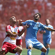 HARRISON, NEW JERSEY- JULY 24: David Villa #7 of New York City FC is challenged by Aurelien Collin #78 of New York Red Bulls during the New York Red Bulls Vs New York City FC MLS regular season match at Red Bull Arena, Harrison, New Jersey on July 24, 2016 in Harrison, New Jersey. (Photo by Tim Clayton/Corbis via Getty Images)
