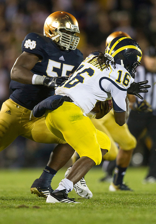 September 22, 2012:  Michigan quarterback Denard Robinson (16) runs for yardage as Notre Dame outside linebacker Prince Shembo (55) defends during NCAA Football game action between the Notre Dame Fighting Irish and the Michigan Wolverines at Notre Dame Stadium in South Bend, Indiana.  Notre Dame defeated Michigan 13-6.