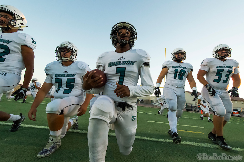 The Sheldon High School Huskys come on to the field before the game as the Monterey Trail Mustangs host the Sheldon High School Huskies Friday Sep 23, 2016.<br /> photo by Brian Baer