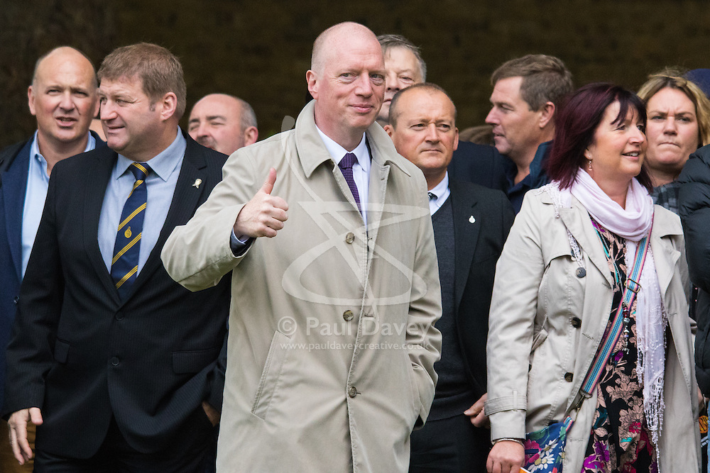 Westminster, London, October 14th 2015. Members of the FBU gather outside Parliament as they prepare to lobby MPs over cuts, the Trade Union Bill and the possibility of their service falling under the control of Police and Crime Commissioners. PICTURED:  FBU Secretary General Matt Wrack, centre, prepares to enter Parliament.