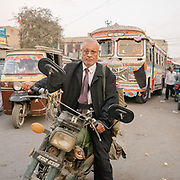 A lawyer from the court. Traffic opposite the Empress Market. Situated in the Saddar Town locality of Karachi, the market traces its origins to the British Raj era.