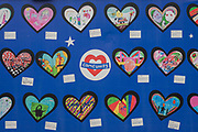 On the first anniversary of the Grenfell tower block disaster a wall where local schoolchildren have drawn pictures and messages, on 14th June 2018, in London, England. 72 people died when the tower block in the borough of Kensington & Chelsea were killed in what has been called the largest fire since WW2. The 24-storey Grenfell Tower block of public housing flats in North Kensington, West London, United Kingdom. It caused 72 deaths, out of the 293 people in the building, including 2 who escaped and died in hospital. Over 70 were injured and left traumatised. A 72-second national silence was held at midday, also observed across the country, including at government buildings, Parliament.
