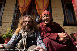Bear Haughton with a monk at the Buddhist monastery in Marpha on day-5  of our Himalayan Heroes adventure riding from Kalopani through the Mustang District to our highest elevation of the trip at over 12,000' when we reached Muktinath, Nepal. Saturday, November 10, 2018. Photography ©2018 Michael Lichter.