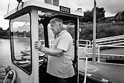 Schellebelle, Belgium, 5 sep 2017, After being kidnapped while working as a captain for an oilcompany, Peter choose a more relaxed life and became ferry-man. However on a busy day Peter crosses the river scheldt more than 250 times.