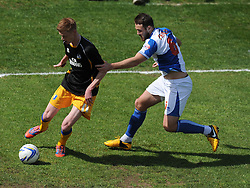 Mansfield Town's Sam Clucas shields the ball from Bristol Rovers' Tom Parkes - Photo mandatory by-line: Alex James/JMP - Mobile: 07966 386802 03/05/2014 - SPORT - FOOTBALL - Bristol - Memorial Stadium - Bristol Rovers v Mansfield - Sky Bet League Two