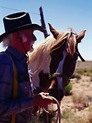 Johnny Johnson with horse on the Painted Desert east of Holbrook, Arizona.
