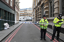 Police remain at Borough Market following the terror attack in which eight people died.