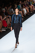 Navy pants and matching top with a glittery blue collarless jacket. By Monique Lhuillier at Spring 2013 Fall Fashion Week in New York.