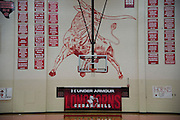"""Under Armour branding in the basketball gym at Cedar Hill High School in Cedar Hill, Texas on August 24, 2016. """"CREDIT: Cooper Neill for The Wall Street Journal""""<br /> TX HS Football sponsorships"""