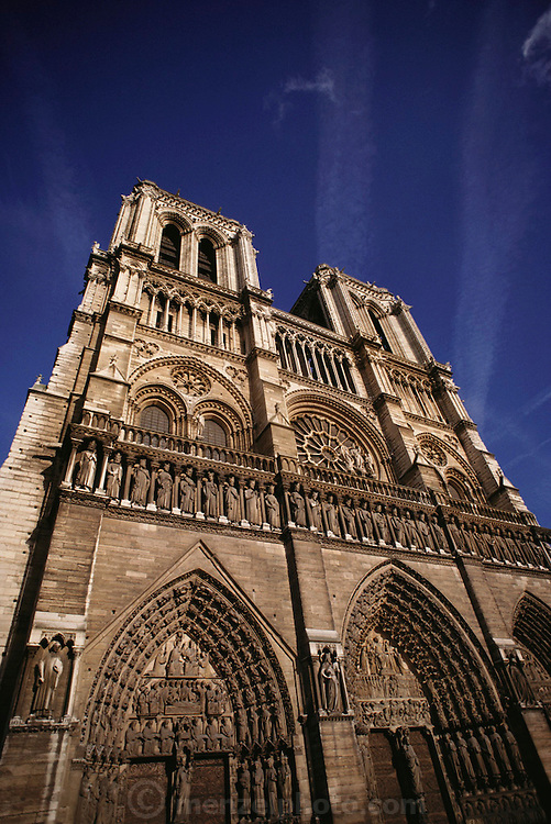 Notre Dame Cathedral with contrails and blue sky. Paris, France.