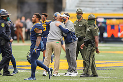 Oct 3, 2020; Morgantown, West Virginia, USA; West Virginia Mountaineers head coach Neal Brown speaks with Baylor Bears head coach Dave Aranda after the game at Mountaineer Field at Milan Puskar Stadium. Mandatory Credit: Ben Queen-USA TODAY Sports
