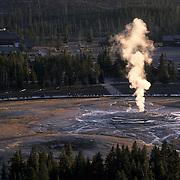 Old Faithful sends out steam prior to erupting in Yellowstone National Park.