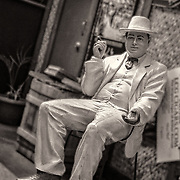 This fellow is sitting outside of the cigar store at the Arthur Avenue market enjoying a cigar.  I like the black and white/sepia treatment much better than the original color version