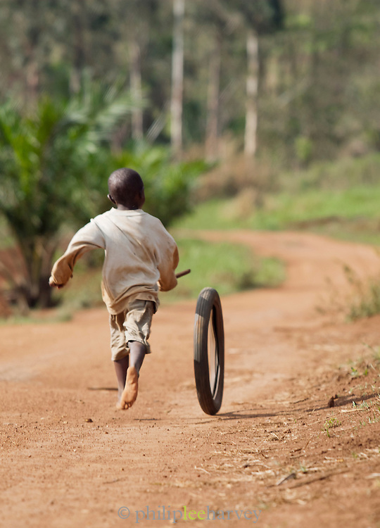A young boy plays along the Ring Road in north-western Cameroon, near Babungo.