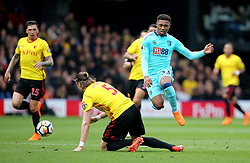 """AFC Bournemouth's Jordon Ibe (right) jumps over a challenge from Watford's Sebastian Prodl (left) during the Premier League match at Vicarage Road, London. PRESS ASSOCIATION Photo. Picture date: Saturday March 31, 2018. See PA story SOCCER Watford. Photo credit should read: Mark Kerton/PA Wire. RESTRICTIONS: EDITORIAL USE ONLY No use with unauthorised audio, video, data, fixture lists, club/league logos or """"live"""" services. Online in-match use limited to 75 images, no video emulation. No use in betting, games or single club/league/player publications."""
