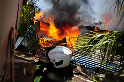 South Africa - Cape Town - 23 October 2020 -  An informel house in the backyard of a home in Kayamandi was destroyed in a fire on Friday afternoon. There were no reports of any injuries. With the quick response of the Stellenbosch Fire and Rescue teams the fire was quickly contained. Picture Henk Kruger/African News Agency (ANA)